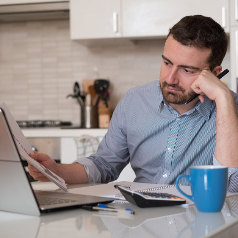 Man checking credit report on computer