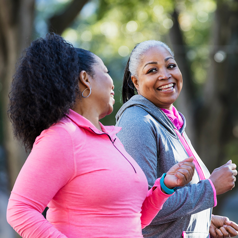 Two women go walking together for exercise