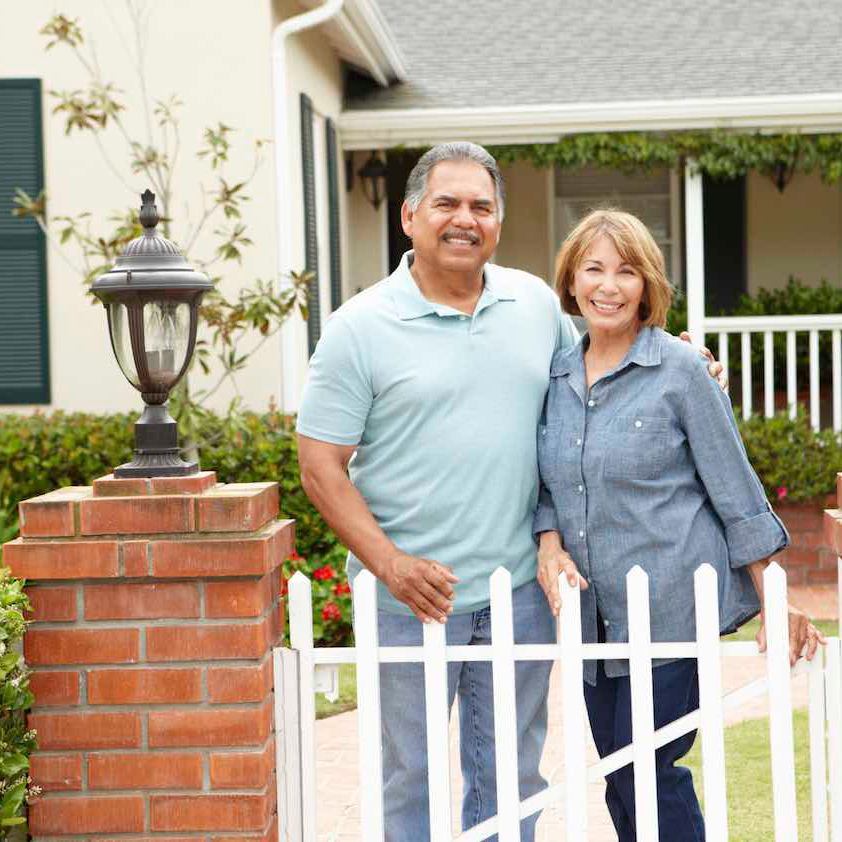 couple standing outside of house